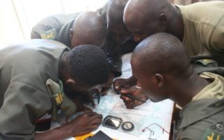 Students learning how to use a map © SAWC/SAWCT